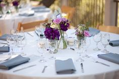 pretty tablescape, gray napkins, white table linens, purple flower centerpieces, blue, white and purple wedding, romantic wedding, golden li...