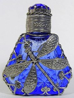 Perfume Bottle beautiful blue glass and dragonfly motif.  Blue my mind.. now give me a sip www.sisterswithbeauty.com approved