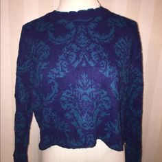 "Vintage floral flower cropped sweater urban blue Gorgeous vintage urban renewal crew neck floral sweater. New and just so cute! Has a scalloped like neckline and a raw edge bottom hem. Made in USA of recycled vintage fabrics. Bust across 22.5 length 18.5"" tag says one size so it's however you like your sweaters to fit! Urban Outfitters Sweaters Crew & Scoop Necks"