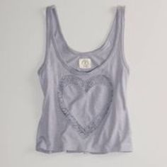 "♣️ American eagle vintage T heart tank top This is a cute American Eagle Outfitters vintage T tank top. Size medium slightly cropped. Crotchet heart detail on the front. Made of 60% cotton 40% modal. Bust 34"" length 21"".  TradesModeling ✅Smoke free home✅  ✅Offers considered✅ Please use the blue 'offer' button to submit an offer.   Bundle 2 or more items for an automatic 15% discount. American Eagle Outfitters Tops Tank Tops"
