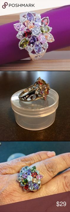 Silver Gemstone Ring Stamped Silver Cocktail 🍹 Ring. This ring has Garnets, Peridot, Amythest, and Sapphires. The stone in the middle is a white sapphire. This ring is absolutely stunning in and has plenty of shine Jewelry Rings