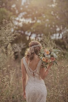 ROMANTIC AUCKLAND WEDDING BY DANELLE BOHANE holymoly! i LOVE EVERYTHING - this dress, headpiece flowers! bohemian wedding