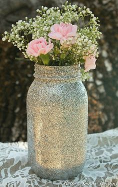 Glitter mason jar with baby's breath and a few carnations (or ranunculus!) for the bar height tables outside... or a few for the bar itself