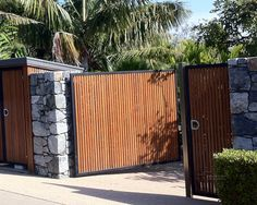 Stone walls of larger, gray pieces in many shades & a folding privacy gate. However, I would prefer bifold gate doors and a uniform color for the gate such as shiny black