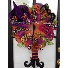 Halloween Wreath with Witch Hat and dangling legs. Submitted to Craftoutlet's photo contest by Jayne's Wreath Designs