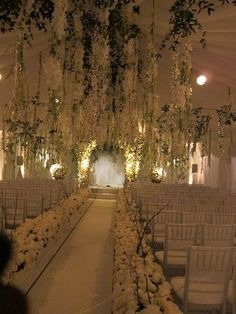 A bit over the top, but I like the general concept...the flowers from ceiling and add fairy lights
