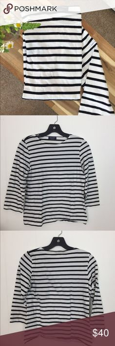 Saint James 3/4 Sleeve Striped T-Shirt Classic French brand, Saint James has been making this Breton style since 1889. Channel your inner Audrey Hepburn ingenue or capture that Alexa Chung je ne said quoi cool with this 3/4 sleeved t-shirt! Made in France, this super soft cotton t will become your new wardrobe staple. Saint James Tops Tees - Long Sleeve