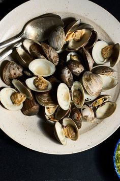 NYT Cooking: Recipes do not come easier, though you will want to make sure that you take the time to scrub the shells before steaming. There's nothing worse than sand in your clams. The bacon is optional, but I like the smokiness it adds to the broth. As for the jalapeño butter, it provides a zip against the brine and sweetness. You can heat it to make a brown butter, add...