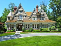 This Riverside, Connecticut home blends Tudor with Shingle Style for a fascinating look...