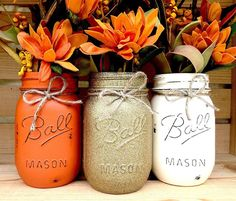 Decorative Set of 3 Hand-Painted Ball Mason Jars in our own unique Fall themed colors ready to be placed in your beautiful Fall setting! This set includes 3 pint size (16 oz.) jars, beautifully painted and then carefully distressed for that rustic look we all love! We then seal each jar with a matte sealant and then finish off with a jute twine bow. Use our sets of 3 for some inspiration, or pick your own 3 colors from picture 5! **PLEASE READ! You choose color 1 and color 2 in the drop down…
