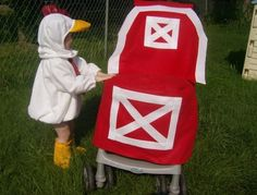 A chicken costume for her, a barn costume for the stroller.  LOVE!