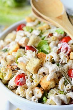 This Chicken Caesar Pasta Salad is perfect for summer. Loaded with fresh produce and tender chicken. Super simple to make and a total crowd pleaser.