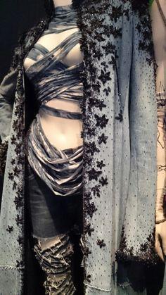 Exposition Jean Paul GAULTIER PARIS jusqu'au 3 août 2015. Maxi manteau en jean rebrodé de jais.  Coll. Ambiance Salon Haute Couture 1997.