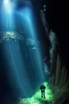 Anhumas Abyss is a cave 23km from the city of Bonito Mato Grosso do Sul, Brazil. During some days of the year the sun passes through the small opening of the cave, producing a beam of light that illuminates the cave for a few hours.