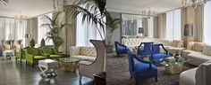 Green and blue accent chairs add a pop of color to the ground floor at Viceroy Santa Monica.