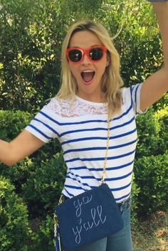 Reese Witherspoon wearing Draper James Tailgate Tee and Draper James Denim Go…