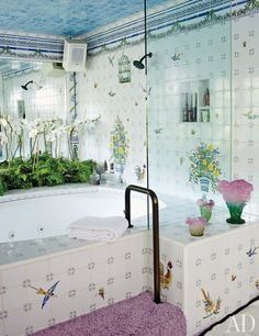 Fanciful tiles give actress Elizabeth Taylor's master bath a garden-like air.