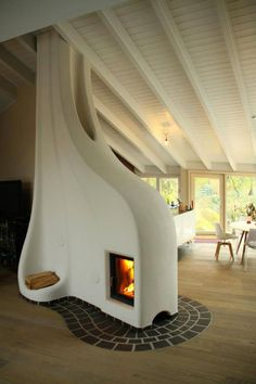 fireplace surrounded by sculpted cob - a mixture of clay, sand & straw - that absorbs the heat from the fire and stays warm long after the fire is done burning. Much more efficient than a regular fireplace (which can have a net cooling effect).