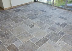 Silver travertine is growing in popularity. This type of tile has more color variance which can make for a beautiful dynamic floor! The light grout does nothing for me, but the colors of the tiles are exactly what I'm looking for. Porch Tile, Patio Tiles, Porch Flooring, Concrete Patio, Kitchen Flooring, Outdoor Tiles, Outdoor Rooms, Stone Tile Flooring, Travertine Floors
