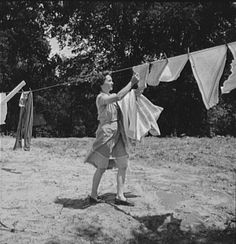 Taking the clothes in off the line - hurry, before it rains!  Remember how they smelled ...