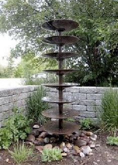 Seems like it could be copied and done with potting platters, pvc pipe, and a water feature kit. [Farm Tiller repurposed as water feature. Outdoor Projects, Garden Projects, Garden Tools, Outdoor Ideas, Outdoor Stuff, Water Features In The Garden, Unique Gardens, Beautiful Gardens, Parcs