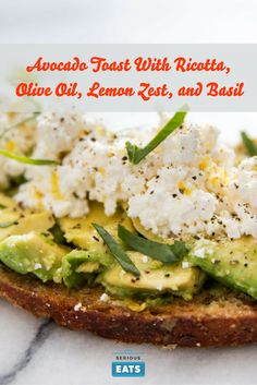 This open-faced sandwich pairs avocado with Italian flavors like creamy ricotta, extra-virgin olive oil, bright lemon zest, and fragrant basil.
