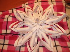 Large snow flake made with 10 pieces of computer paper,tape and staples. Love these<3
