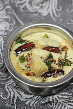 An every day and festive South Indian dish made of raw banana cooked in a spicy coconut and yogurt based gravy that is served with rice.