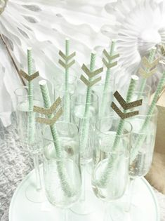 Gorgeous way to dress up your drinks at a baby shower…paper straws and arrows! Via Kara's Party Ideas @HUGGIES Baby Shower Planner Baby Shower Planner