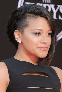 Gina Rodriguez showed off her edgy haircut as she posed in her formfitting black cutout Safiyaa gown.