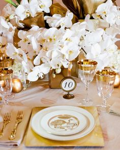"""To keep the focus on the metallic color you choose and make sure the design doesn't feel too busy, keep the florals clean and stick to a simple color palette. For example for this design we used Phalaenopsis Orchids and large Calla Lillies in white."" - Sarah Hackforth & Jenny Zukovsky, Owners, Fionna Floral"