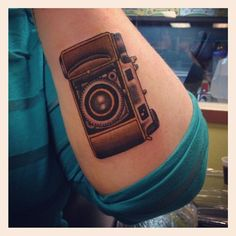 Awesome camera tattoo that Amanda got!  Done at Resurrection Tattoo in Austin by Ben T. Fiedler (http://bentfiedler.com/home.html)  Check out Amanda's photos: www.amanda-klaus.com