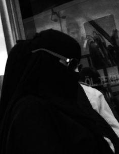 Woman in black. The harbour, Kabatas, Istanbul.