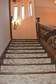 Stairs Idea. Really like this look. It would tie in our tile from our 1st floor to the carpet upstairs nicely.