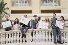 sucha cute wedding picture idea except I feel like the guy on the right is gonna fall off!