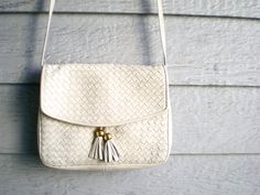 vintage woven leather purse with tassels. over the shoulder bag by Ganson. at ReRunRoom,