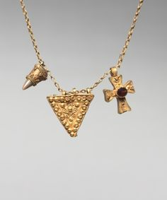 Chain with two pendants and a cross, gold with granulation and a garnet. Byzantium, 6th century