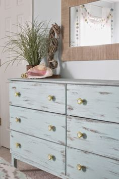 Beach themed bedroom Aqua painted unfinished dresser from Ikea
