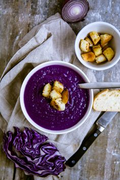 "Red cabbage soup - Red cabbage soup  Recipe for 6 servings adapted from ""Amore: My love for Italian cuisine"" *  For the soup 1 small red cabbage (about 1kg) 375g (red) Potatoes 1/2 red onion 1 clove of garlic 1-1,25l hot vegetable stock some olive oil Salt + Pepper 1 tablespoon rice syrup (or other sweetness) 2-3 tablespoons lemon juice  For the croutons 4 slices of stale baguette some olive oil"