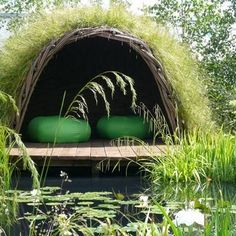A human nest with a living roof, a deck and a view of the water. And green furniture, of course. I most certainly need this.