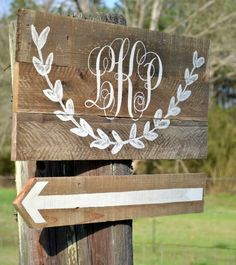 love this painted wedding sign with the vine/branchy stuff and monogram, super sweet and vintagey looking