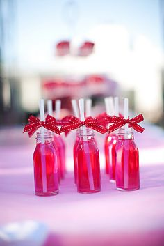 Fuchsia / Hot Pink Wedding. Pink drink with red bows