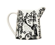 Pitcher Add the iittala Taika White/Black 17 oz. Pitcher to your iittala dinnerware collection. Klaus Haapaniemi's whimsical pattern now adorns a perfectly petite porcelain pitcher that is charming yet versati.