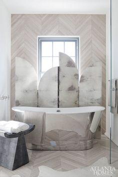 Marble bathroom with beautiful chrome bathtub