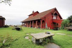 Old red barn on a coastal farm in Larvik, Norway.
