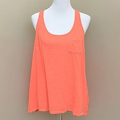 Lucky Brand Lotus Yoga Crossover Coral Tank Top Boho coral tank top is the perfect top sunny summer days! Versatile, yoga-inspired tank top featuring a scoop neck, crossover back, shirttail hem and single front pocket. Perfect with any out fit! Hangs longer in back then front- approx 25 inches long. Brand new with tags! Lucky Brand Tops Tank Tops