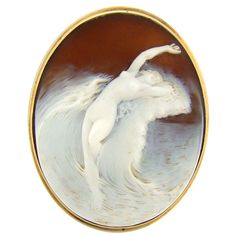 1890  A beautiful example of Venus rising in the ecstasy. Wonderful varying depths and flow. Measures 2.125 inches in height by 1.75 inches in width.