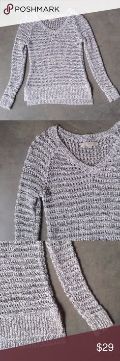 """LOFT Black and White Open Knit Sweater Ann Taylor LOFT sweater, size small, in excellent condition! Chunkier/thicker open knit. Black and white pattern of fabric gives it more of a gray color. V-neck and slits at bottom sides. Slim and fitted style. Will need a cami/tank underneath. 19"""" pit to pit, 24"""" length. 39% nylon, 32% cotton, 28% acrylic, 1% other fiber. Tag says hand wash but I've washed in the machine no problem.No trades. No modeling. Make a reasonable offer. Thanks! LOFT Sweaters…"""