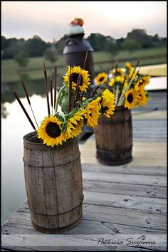 Mini barrel's with sunflowers for rustic fall wedding