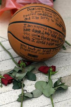 Flowers lay alongside a basketball fans have left at the Pat Summitt statue Tuesday, June 28, 2016, in Knoxville. (AP Photo/Wade Payne)